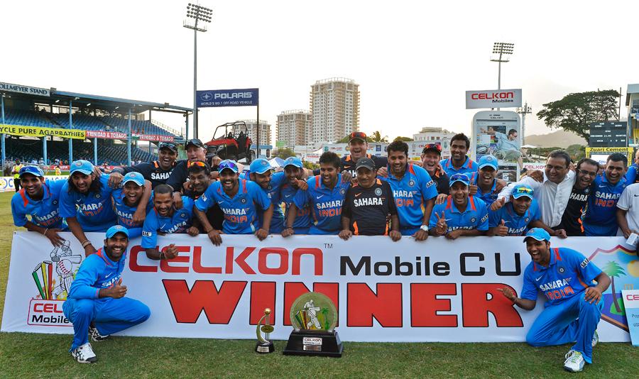 India celebrate with their spoils
