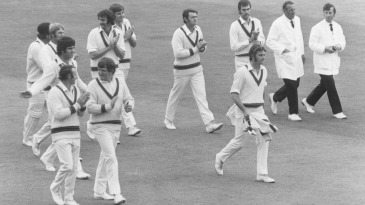 Bob Massie is clapped off the field by his team-mates