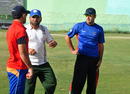 Afghanistan coach Kabir Khan advises players at a training camp, Kabul, July 23, 2013