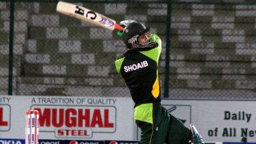 Shoaib Malik slams one over the bowler's head