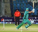 Hasan Raza punches through the offside, Habib Bank Limited v Port Qasim Authority, Ramadan T20 Cup, 2nd semi-final, Karachi, July 24, 2013