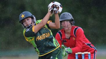 Sana Mir lofts the ball over the top