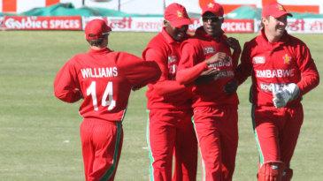 Zimbabwe fielders celebrate Rohit Sharma's dismissal