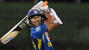 Dinesh Chandimal powers the ball through the off side