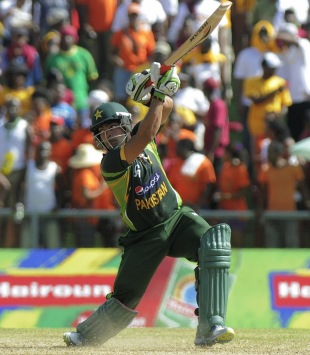 Umar Akmal's late burst gave Pakistan enough to defend