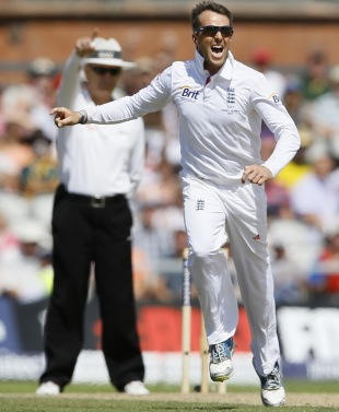 Graeme Swann is ecstatic after picking up David Warner's wicket, England v Australia, 3rd Investec Test, Old Trafford, 2nd day, August 2, 2013