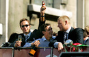 Michael Vaughan, Gary Pratt and Andrew Flintoff ride on top of the bus in the victory parade, London, September 13, 2005