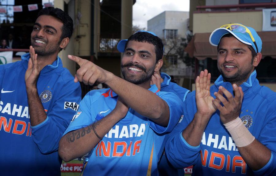 Jaydev Unadkat, Ravindra Jadeja and Suresh Raina celebrate India's win