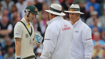 Michael Clarke chats animatedly with the umpires