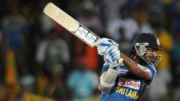 Kumar Sangakkara drives at the ball