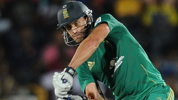 Faf du Plessis looks to chip it over the off side