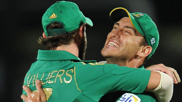 AB de Villiers and Faf du Plessis embrace after a wicket falls