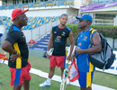 Antigua Hawksbills coach Vivian Richards and Barbados Tridents coach Desmond Haynes have a chat at a training session, Bridgetown, July 31, 2013