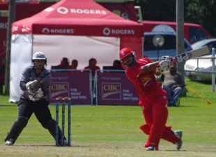 Hiral Patel lofts the ball during his half-century, Canada v UAE, ICC World Cricket League Championship, King City, August 8, 2013