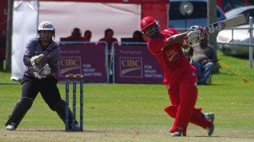 Hiral Patel lofts the ball during his half-century