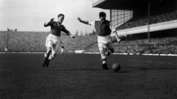 Denis Compton (right) plays against Chelsea at Highbury
