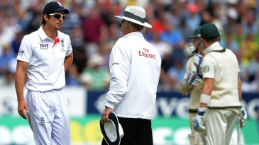 Alastair Cook speaks to Tony Hill after a DRS appeal was overturned