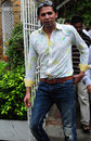 Mohammad Asif leaves a press conference in Karachi, August 14, 2013
