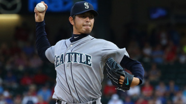 Baseball player Hisashi Iwakuma pitches