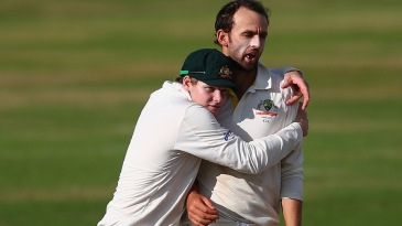 Nathan Lyon gets a hug from Steven Smith after claiming a wicket