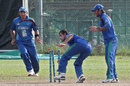 Izatullah Dawlatzai completes Bilawal Bhatti's run-out, Afghanistan Under-23s v Pakistan Under-23s, Group A, Asian Cricket Council Emerging Teams Cup, Singapore, August 19, 2013
