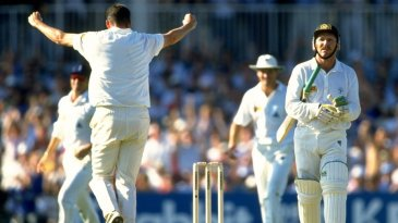 Angus Fraser takes the wicket of Allan Border