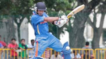 Unmukt Chand plays an attacking shot on the off side