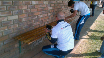 Titans players paint benches at the Mamelodi Cricket Club