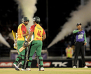 The umpire signals a Tillakaratne Dilshan boundary, Trinidad & Tobago Red Steel v Guyana Amazon Warriors, Caribbean Premier League 2013, 1st semi-final, Port-of-Spain, August 22, 2013