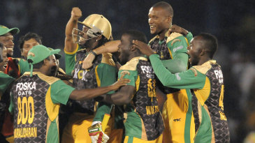 Chris Gayle is surrounded by team-mates after the win