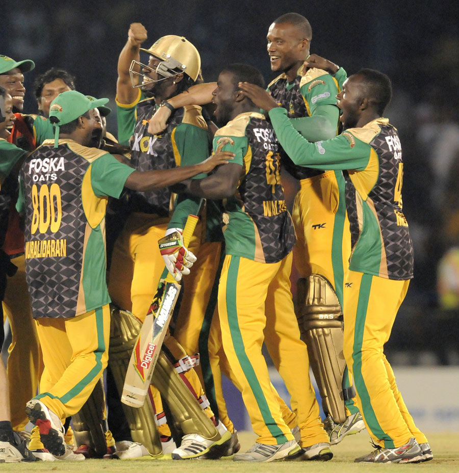 Chris Gayle is surrounded by team-mates after the win ...