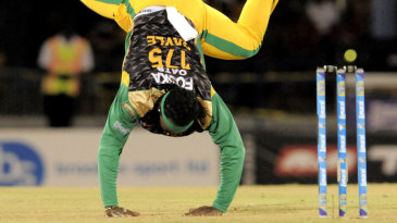 An off-balance Chris Gayle tries to regain his footing