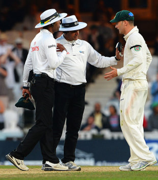 Kumar Dharmasena and Aleem Dar try to appease an agitated Michael Clarke, England v Australia, 5th Investec Test, The Oval, 5th day, August 25, 2013