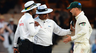Kumar Dharmasena and Aleem Dar try to appease an agitated Michael Clarke
