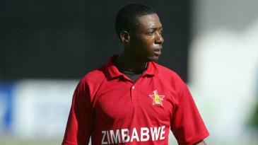 Vusi Sibanda walks back after scoring 54