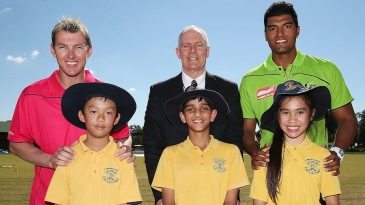 Brett Lee, Greg Chappell and Gurinder Sandhu pose with kids at a Cricket Australia community event