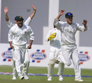 Dion Ebrahim and Trevor Gripper celebrate the dismissal of Hamish Marshall, Zimbabwe v New Zealand, 1st Test, Harare, 1st day, August 7, 2005