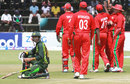 The Zimbabwe players celebrate Umar Amin's run-out, Zimbabwe v Pakistan, 2nd ODI, Harare, August 29, 2013