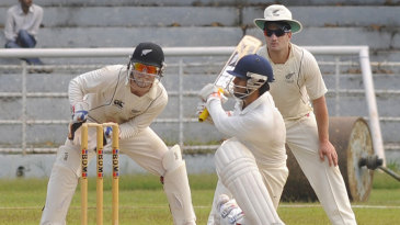 Abhishek Nayar sweeps the ball