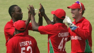 Tendai Chatara is congratulated after Nasir Jamshed's wicket