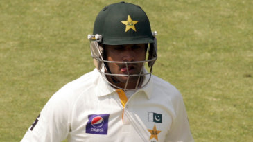Mohammad Hafeez trudges back to the pavilion after a low score