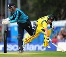 David Murphy flicks the bails off as Aaron Finch runs in, Scotland v Australia, only ODI, Edinburgh, September 3, 2013