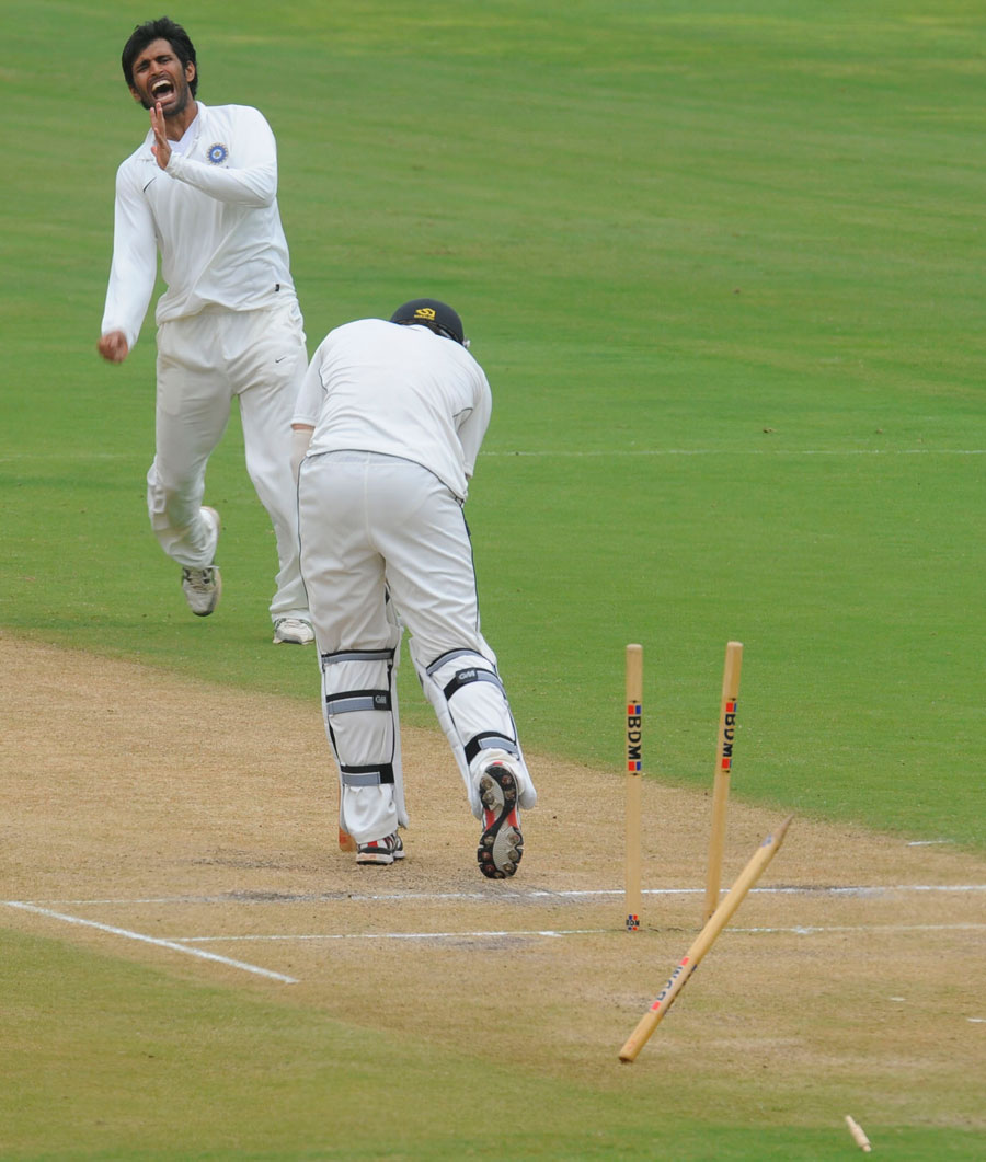 Abhishek Nayar cries in delight after knocking over Doug Bracewell's middle stump, India A v New Zealand A, 2nd unofficial Test, Visakhapatnam, Sep 3, 2013