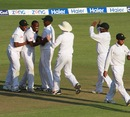 Shingi Masakadza is mobbed after dismissing Misbah-ul-Haq, Zimbabwe v Pakistan, 1st Test, 3rd day, Harare, September 5, 2013
