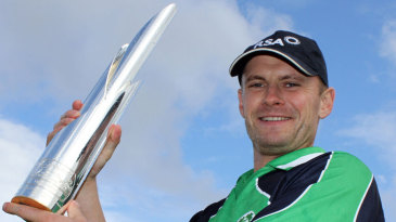 Ireland captain William Porterfield holds up the WCL Championship trophy