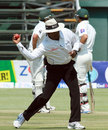 Umpire Ranmore Martinesz set to throw the ball, Zimbabwe v Pakistan, 2nd Test, Harare, 3rd day, September 12, 2013
