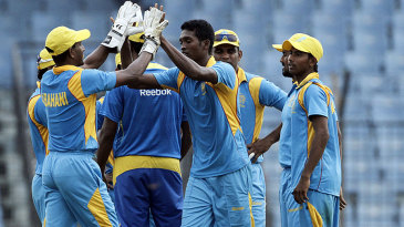 Al-Amin Hossain celebrates a wicket with his Abahani team-mates