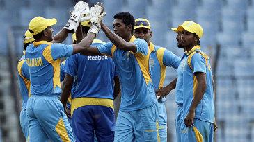 Al-Amin Hossain celebrates a wicket with his Abahani team-mates