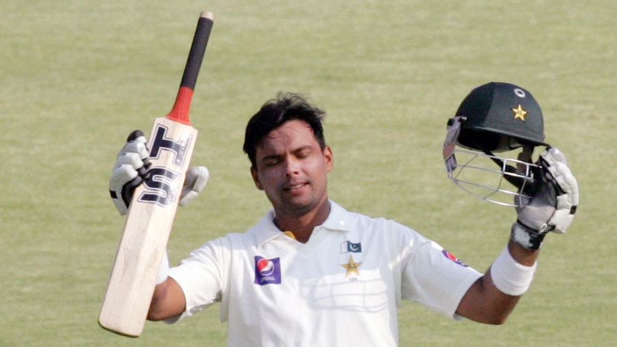 Khurram Manzoor raises the bat after reaching his fifty