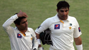 Misbah-ul-Haq and Adnan Akmal walk off the pitch at the end of the day